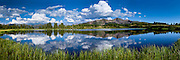 A perfect day as clouds reflect on Little Molas Lake in the Colorado Rocky Mountains