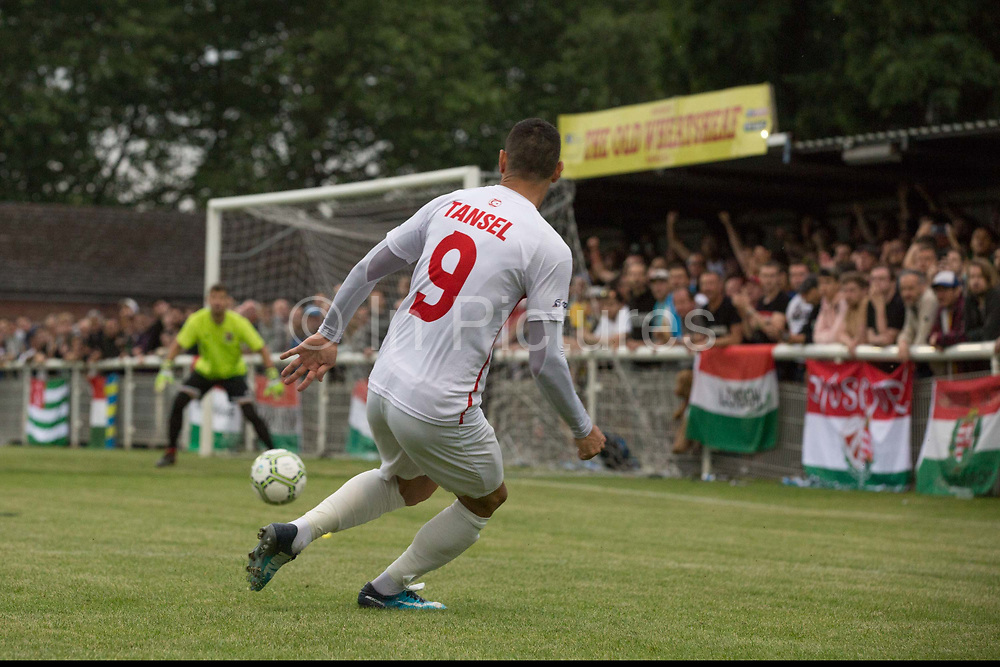 Tansel Ekingen on the attack Northern Cyprus. Karpatalya (RED) beat Northern Cyprus (WHITE) 3 -2 in penalties during the Conifa Paddy Power World Football Cup finals on the 9th June 2018 at Queen Elizabeth II Stadium in Enfield Town in the United Kingdom. Team mates from the Turkish Republic of Northern Cyprus  take on the Hungarians in Ukraine for the CONIFA World Football Cup final. CONIFA is an international football tournament organised by CONIFA, an umbrella association for states, minorities, stateless peoples and regions unaffiliated with FIFA. (photo by Sam Mellish / In Pictures via Getty Images)Karpatalya (RED) beat Northern Cyprus (WHITE) 3 -2 in penalties during the Conifa Paddy Power World Football Cup finals on the 9th June 2018 at Queen Elizabeth II Stadium in Enfield Town in the United Kingdom. Team mates from the Turkish Republic of Northern Cyprus  take on the Hungarians in Ukraine for the CONIFA World Football Cup final. CONIFA is an international football tournament organised by CONIFA, an umbrella association for states, minorities, stateless peoples and regions unaffiliated with FIFA. (photo by Sam Mellish / In Pictures via Getty Images)
