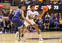 Dec 1, 2019; Morgantown, WV, USA; West Virginia Mountaineers guard Miles McBride (4) passes during the second half against the Rhode Island Rams at WVU Coliseum. Mandatory Credit: Ben Queen-USA TODAY Sports
