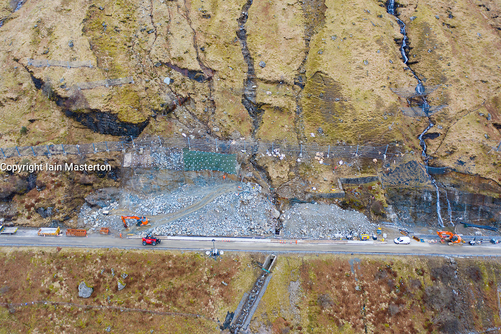 Glen Croe, Arrochar, Scotland, UK. 22 Feb 2021. Aerial view of landslide preventative engineering works to A83 at rest and be Thankful Pass in Glen Croe. The important route has been plagued by landslips which have often closed the main A83 carriageway forcing traffic to use single track Old Military road below. Latest landslides have  even blocked this road. Currently traffic is escorted one way in convoys. Pic; Engineering work ongoing at A83.  Iain Masterton/Alamy Live News