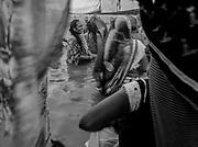 A group of Hindu women perform the bathing ritual during Kumbh Mela 2019, Prayagraj, India.