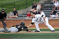 WINSTON-SALEM, NC - JUNE 02: UMBC's Andrew Casali (6) beats a pickoff throw to Wake Forest's Gavin Sheets (24) back to first base. The Wake Forest Demon Deacons hosted the University of Maryland Baltimore County Retrievers on June 2, 2017, at David F. Couch Ballpark in Winston-Salem, NC in NCAA Division I College Baseball Tournament Winston-Salem Regional Game 2. Wake Forest won the game 11-3.