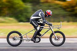 © Licensed to London News Pictures. 15/09/2018. York UK. Neil Campbell is attempting to break his own European motor paced cycling speed record of 135.5 Mph this weekend at the Straight liners speed event at Elvington Airfield near York. Architect Neil is towed up to speed behind a 4x4 Porsche on the Runway at Elvington airfield in Yorkshire before being released to power himself to top speed. Photo credit: Andrew McCaren/LNP