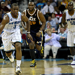 April 11, 2011; New Orleans, LA, USA; New Orleans Hornets point guard Chris Paul (3) drives down the court against the Utah Jazz during the second half at the New Orleans Arena. The Jazz defeated the Hornets 90-78.  Mandatory Credit: Derick E. Hingle