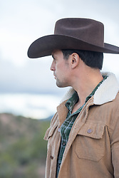 cowboy looking at a mountain range