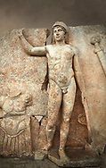 Close up of a Roman Sebasteion relief  sculpture of Ares, Aphrodisias Museum, Aphrodisias, Turkey.  Against an art background.<br /> <br /> The nude and classically7 styled young god wears only a helmet and holds a spear (missing) in one hand and a shield in the other. At the left stands cuirass, and at the upper right corner hangs his sword. Ares was a god of war and was not later defaced by Christians probably because he so closely resembles a young emperor. .<br /> <br /> If you prefer to buy from our ALAMY STOCK LIBRARY page at https://www.alamy.com/portfolio/paul-williams-funkystock/greco-roman-sculptures.html . Type -    Aphrodisias     - into LOWER SEARCH WITHIN GALLERY box - Refine search by adding a subject, place, background colour, museum etc.<br /> <br /> Visit our ROMAN WORLD PHOTO COLLECTIONS for more photos to download or buy as wall art prints https://funkystock.photoshelter.com/gallery-collection/The-Romans-Art-Artefacts-Antiquities-Historic-Sites-Pictures-Images/C0000r2uLJJo9_s0