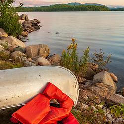 A canoe on the shore of Umbagog Lake at Umbagog Lake State Park, Cambridge, New Hampshire.