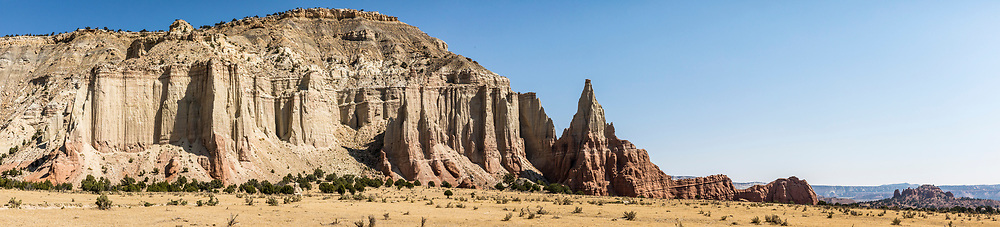 A spire and eroding cliffs and mesa near Kodachrome Basin State Park, Utah, USA.