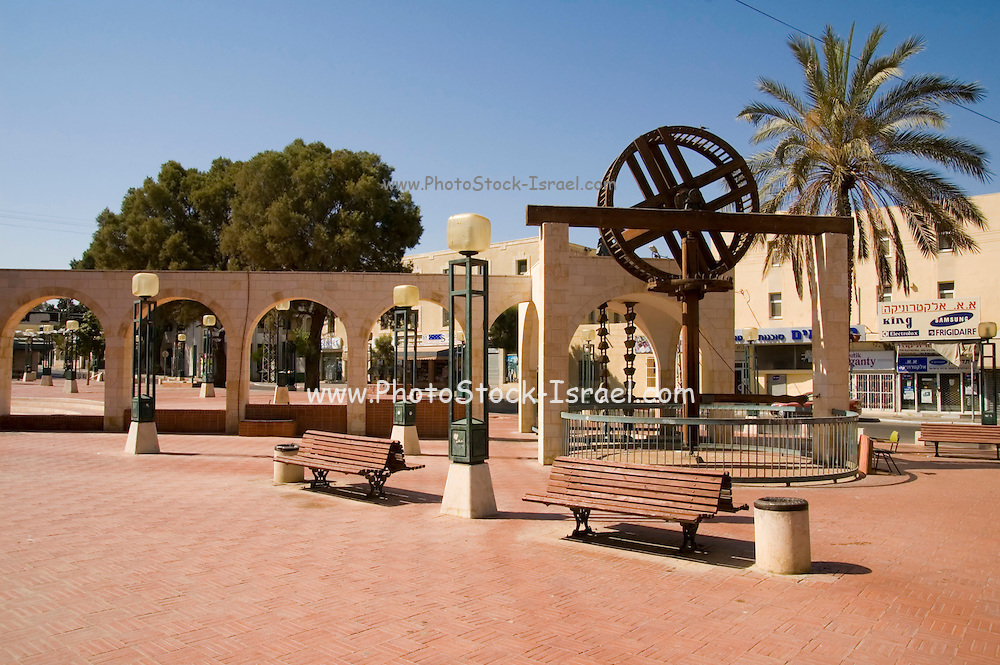 Israel, Negev, Be'er Sheva. City square in the old city, a replica of an ancient ox drawn, water pumping system from a well