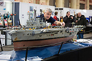 Dave Fortey tends to his model of HMS Ark Royal R09 at the London Model Engineering Exhibition at Alexandra Palace on January 1st, 2018. Mr Fortey, a former Royal Navy mechanic and sub-lieutenant, built the model over 25 years and it is the first time it has been put on display to the public. This week, the Government has launched a campaign to inspire the next generation. The Year of Engineering, will see government and industry tackle a major skills gap and inspire the engineers of tomorrow.