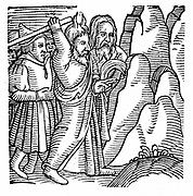 Moses striking the rock in the wilderness and producing water. Woodcut from Conrad Lycosthenes 'Prodigiorum ac ostentorum chronicon', Basel, 1557.