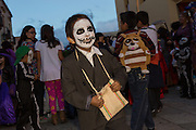 A young boy dressed as a skeleton during the Day of the Dead Festival known in spanish as Día de Muertos October 25, 2014 in Oaxaca, Mexico.