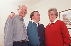 Mother and father with adult son with Downs Syndrome,