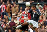 Photo: Gerrit de Heus. Rotterdam. 11/04/04..Feyenoord-Ajax. Kopduel tussen Dirk Kuijt (L) en Nigel de Jong.