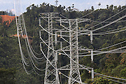 Electricity pylons carry electricity from Bakun Dam towards Bintulu. Bangladeshi workers repairing pylons as natives aren't used to heights. Home of the Kenyah native people who once lived in Long Geng, which was flooded by the Bakun Dam. Their community is now dispersed between Sungai Asap, Long Lewan and floating longhouses on the Bakun reservoir. Bakun Belaga region, Sarawak Borneo 2012..Borneo native peoples and their rainforest habitat revisited two decades later: 1989/1991-2012. ..The Bakun hydro-electric dam, which covers 700km². Construction of the dam required the relocation of more than 9,000 native residents, mainly Kayan and Kenyah indigenous peoples who lived in the flooded area. Many Sarawak natives have been relocated to a longhouse settlement named Sungai Asap in Bakun. Most of them were subsistence farmers. Each family were promised only 3 acres of land, insufficient to survive, and many families still have not been compensated for the loss of their longhouses..Sarawak's primary rainforests have been systematically logged over decades, threatening the sustainable lifestyle of its indigenous peoples who relied on nomadic hunter-gathering and rotational slash & burn cultivation of small areas of forest to survive. Now only a few areas of pristine rainforest remain; for the Dayaks and Penan this spells disaster, a rapidly disappearing way of life, forced re-settlement, many becoming wage-slaves. Large and medium size tree trunks have been sawn down and dragged out by bulldozers, leaving destruction in their midst, and for the most part a primary rainforest ecosystem beyond repair. Nowadays palm oil plantations and hydro-electric dam projects cover hundreds of thousands of hectares of what was the world's oldest rainforest ecosystem which had some of the highest rates of flora and fauna endemism, species found there and nowhere else on Earth, and this deforestation has done irreparable ecological damage to that region.