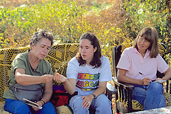 Jackie, Michelle & Kathy Looking At Herbs