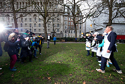 © Licensed to London News Pictures. 13/02/2018. London, UK. The Parliament team practise ahead of the Rehab Parliamentary Pancake Race 2018 in Victoria Tower Gardens. The Parliament Team - made up of MPs, Lords and Ladies - race in a relay against the Media Team - made up of reporters and presenters - whilst continuously flipping pancakes to celebrate Shrove Tuesday, also known as Pancake Day. Photo credit : Tom Nicholson/LNP