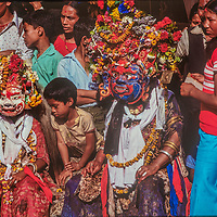 Masked dancers mingle with the crowd s at a Hindu festival in Kathmandu, Nepal.
