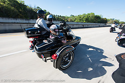 Skyler Keim-Jones, a Florida MDA goodwill ambassador, gets a ride in a Harley sidecar model during Annual MDA Ladies Run to Destination Daytona sponsored by Harley-Davidson every year on the Tuesday of Daytona Beach Bike Week. FL, USA. March 10, 2015.  Photography ©2015 Michael Lichter.