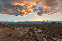 A colorful sunset fills the sky above the McCullough Peak Badlands. This view is looking west towards Cody.