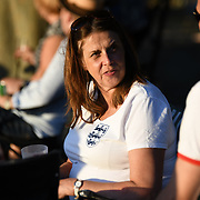 England fan watching England vs Croatia at Kew Garden some with England flag and other with a Union jack painted on the face during the Kew the Music on July 11 2018, London, UK.