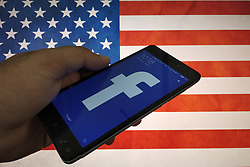 August 1, 2018 - Unspecified, UNSPECIFIED - Facebook Logo can be seen on a mobile phone with US Flag in the background on 1st August 2018. (Credit Image: © Nasir Kachroo/NurPhoto via ZUMA Press)