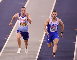 Great Britain's Richard Kilty (left) and Greece's Konstadinos Zikos running in the second semi-final of the Men's 60m during day two of the European Indoor Athletics Championships at the Emirates Arena, Glasgow.
