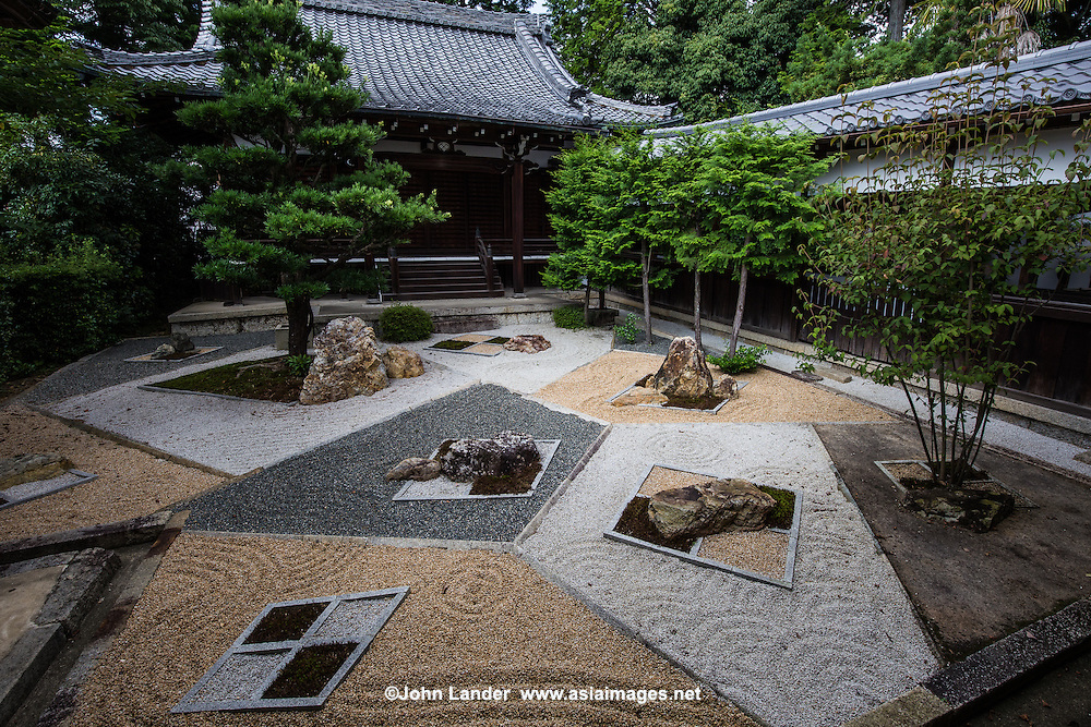 """Mirei Garden at Shinnyodo -  Three gardens are to be found at <br /> Shinnyodo Temple.  The first is the Nehan """"Nirvana"""" garden and was built in the classic karesansui rock garden style in 1988. It uses the shakkei borrowed landscape technique to include Mt. Hiei in its design. The second garden was designed by Shigemori Chisao - Its modern geometrical style is similar in design to his father renowned landscape architect and garden designer Shigemori Mirei. The third is a small tea garden, with its own tea ceremony hut."""