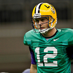 January 5, 2012; New Orleans, LA, USA; LSU Tigers quarterback Jarrett Lee (12) during practice for the 2012 BCS National Championship game to be played on January 9, 2012 against the Alabama Crimson Tide at the Mercedes-Benz Superdome.  Mandatory Credit: Derick E. Hingle-US PRESSWIRE