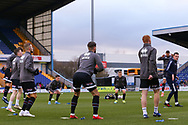 Grimsby Town players warming up before the EFL Sky Bet League 2 match between Mansfield Town and Grimsby Town FC at the One Call Stadium, Mansfield, England on 4 January 2020.