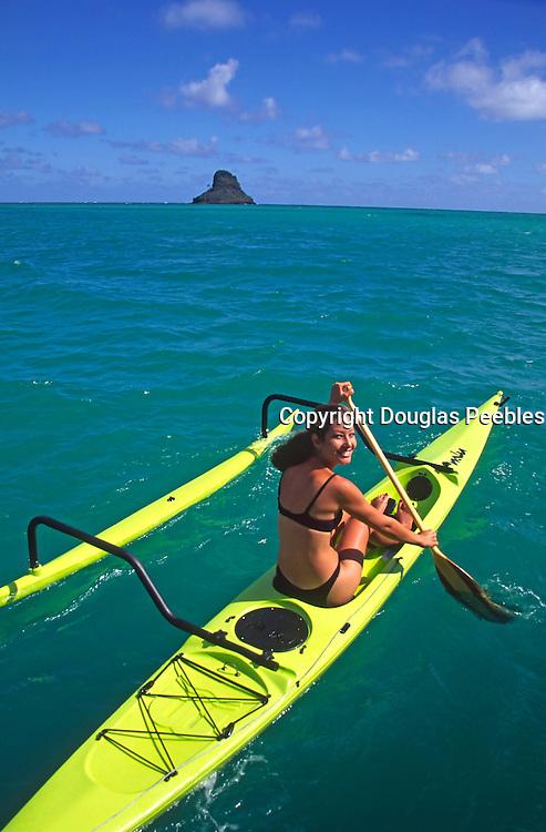 Woman on outrigger canoe, Kaneohe Bay, Oahu, Hawaii<br />