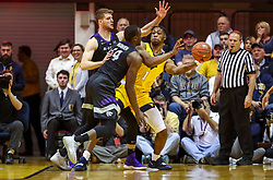 Feb 18, 2019; Morgantown, WV, USA; West Virginia Mountaineers forward Derek Culver (1) is pressured while passing during the first half against the Kansas State Wildcats at WVU Coliseum. Mandatory Credit: Ben Queen-USA TODAY Sports