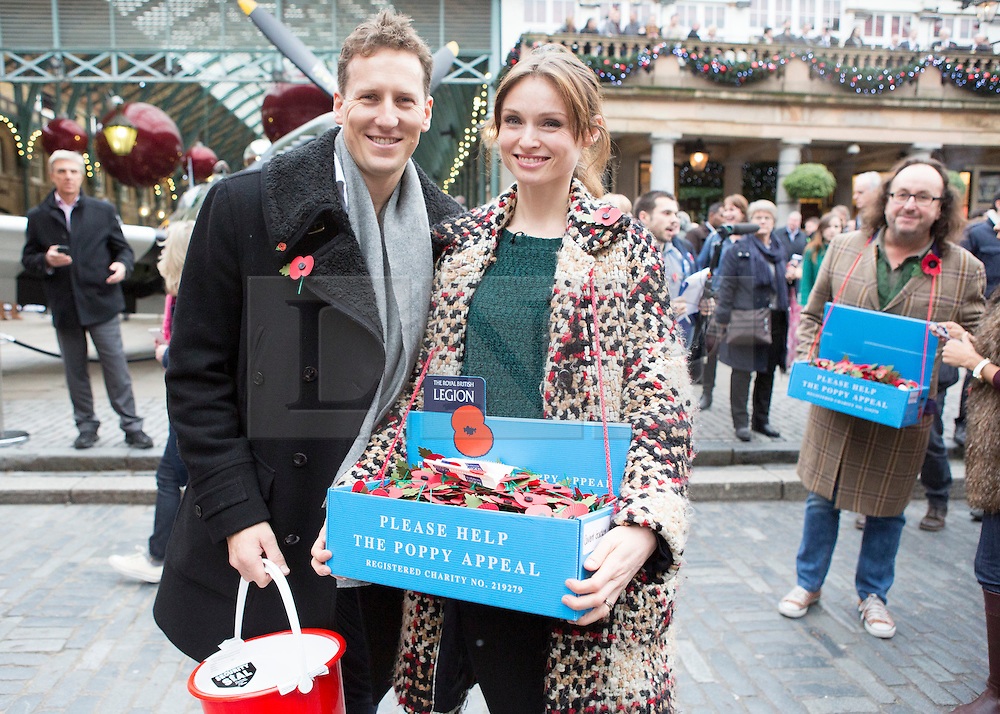 © Licensed to London News Pictures. 07/11/2013.  Strictly Come Dancing stars Sophie Ellis Bexter and Brendan Cole were out today collecting for the Poppy Appeal in Covent Garden as part of London Poppy Day.  The dance stars joined service personnel to help the charity raise one million pounds in the capital today.  Photo credit: Alison Baskerville/LNP