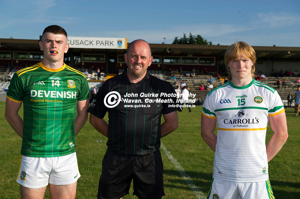 30-06-21. Meath v Offaly - Leinster MFC Final 2020 at TEG Cusack Park, Mullingar.<br /> Meath captain Eoghan Frayne and Offaly captain Cormac Egan with referee David Fedigan, Louth.<br /> Photo: John Quirke / www.quirke.ie<br /> ©John Quirke Photography, 16 Proudstown Road, Navan. Co. Meath. (info@quirke.ie / 046-9028461 / 087-2579454).