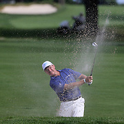 Ernie Els chips out of the sand trap on the 13th hole during the third round of theThe Barclays Golf Tournament at The Ridgewood Country Club, Paramus, New Jersey, USA. 23rd August 2014. Photo Tim Clayton