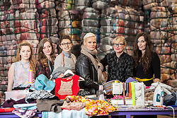 Students Emam McDowall, Lucu Morrant, Hannah McKinnon, Model Anna Freemantle, Scottish fashion designer Niki Taylor and student Allison Radcliffe. Showing fashion students about upcycling clothes, at the UK's second largest textile recycling facility, Nathan's Wastesavers, in Denny.<br /> © Michael Schofield.