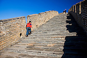 Chinese boy walking the Great Wall of China at Mutianyu, north of Beijing (formerly Peking)