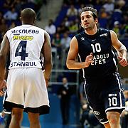 Anadolu Efes's Kerem Tunceri (R) during their Turkish Basketball league derby match Fenerbahce Ulker between Anadolu Efes at the Ulker Sports Arena in Istanbul, Turkey, Monday, April 29, 2013. Photo by Aykut AKICI/TURKPIX