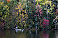 A lakeside swimming platform and some fall foliage on the shore of Lac Hacquard in Saint-Émile-de-Suffolk, Québec, Canada.