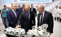June 27, 2017 - Izhevsk, Republic of Udmurtia, Russia - June 27, 2017. - Russia, Republic of Udmurtia, Izhevsk. - Russian President Vladimir Putin visits the Izhevsk Electro-Mechanical Plant Kupol, a member of the Almaz-Antey VKO Concern. Right: Fanil Ziyatdinov, CEO, Izhevsk Electro-Mechanical Plant Kupol. Left: Yan Novikov, CEO, Almaz-Antey VKO Concern. (Credit Image: © Russian Look via ZUMA Wire)