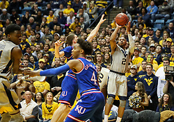 Jan 15, 2018; Morgantown, WV, USA; West Virginia Mountaineers guard Jevon Carter (2) shoots a three pointer during the second half against the Kansas Jayhawks at WVU Coliseum. Mandatory Credit: Ben Queen-USA TODAY Sports