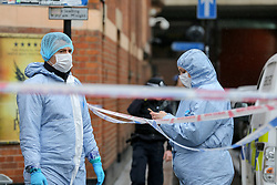 © Licensed to London News Pictures. 03/03/2019. London, UK. Forensic officers at the crime scene outside The Coach and Horses pub in Romilly Street in Soho. According to the police, a man aged 30 yrs old is seriously injured in hospital and a woman has been arrested. Photo credit: Dinendra Haria/LNP