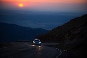 June 26-30 - Pikes Peak Colorado. A Porsche at sunrise during practice for the 91st running of the Pikes Peak Hill Climb.