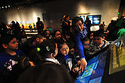 Jorge Caepena, a first grade teacher at John J. Pershing elementary school, leads his students through one of the interactive modules at the Perot Museum of Nature and Science in Dallas on Thursday, April 4, 2013. (Cooper Neill/The Dallas Morning News)