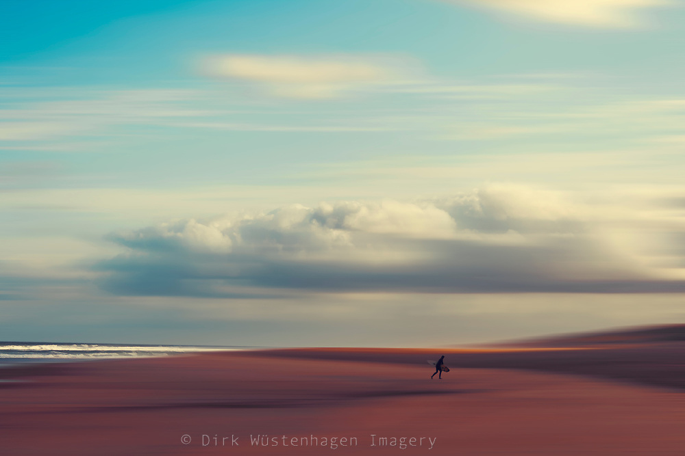 Surfer returning from the sea - abstract photograph