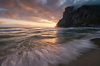 Midnight sun light shines across Kvalvika beach, Moskenesøy, Lofoten Islands, Norway