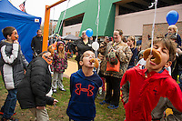 Ryan Suarez and Ben Wolpin get in on the donut eating contest on Punkin CROSSing during Pumpkin Fest on Saturday.   (Karen Bobotas/for the Laconia Daily Sun)