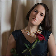 Self portrait with pearls and red rose.