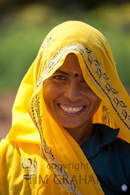 Indian woman villager at farm smallholding at Sawai Madhopur near Ranthambore in Rajasthan, Northern India
