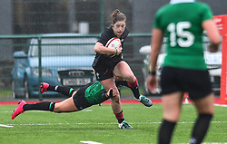 Wales women's Lisa Neumann evades the tackle of Ireland women's Megan Williams<br /> <br /> Photographer Craig Thomas/Replay Images<br /> <br /> International Friendly - Wales women v Ireland women - Sunday 21th January 2018 - CCB Centre for Sporting Excellence - Ystrad Mynach<br /> <br /> World Copyright © Replay Images . All rights reserved. info@replayimages.co.uk - http://replayimages.co.uk